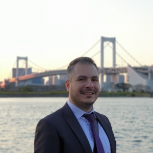 Image of Anthony Constantinou in front of bridge